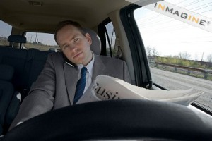 driver_on_cell_and_reading_newspaper