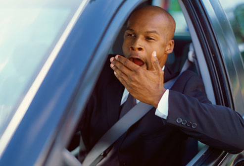 getty_rf_photo_of_man_yawning_while_driving