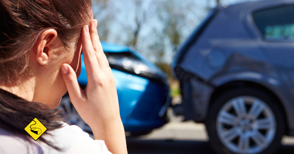 Woman looking on to car accident